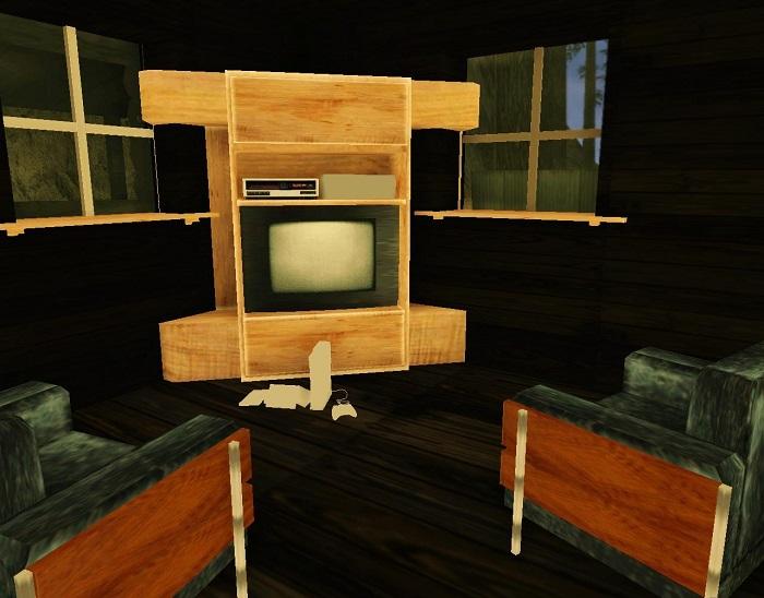 Телевизор и кресла в гостиной
